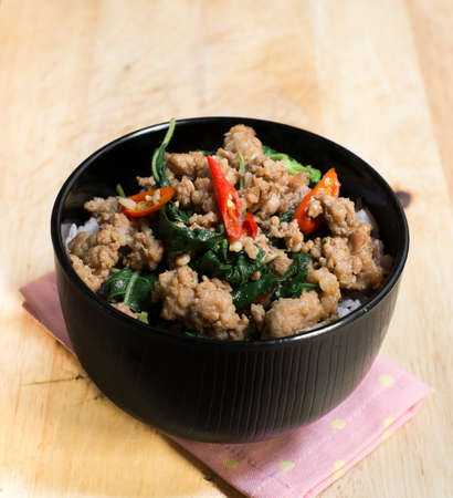 stir up: Close up Rice topped with stir fried minced pork and basil Stock Photo