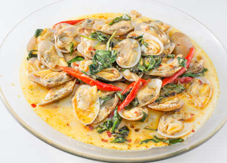 thai basil: STIR FRIED CLAMS WITH ROASTED CHILI PASTE AND THAI BASIL LEAVES.