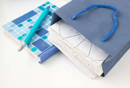 paper stack: paper stack in blue bag and notebook with pen