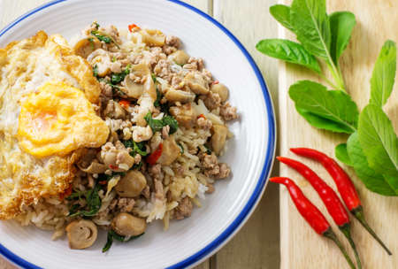 thai basil: pork fried rice and fried egg with basil and chili background