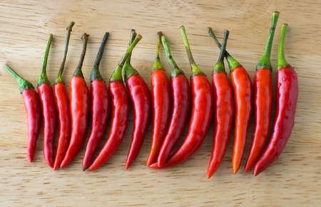 arranged: chili arranged on the wood