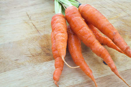rustic: carrots on rustic wood Stock Photo