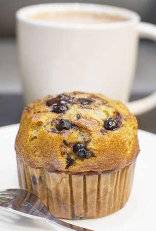 choc: banana choc chip muffin and hot coffee background