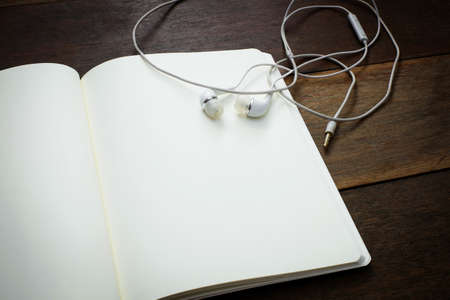 earphone: notebook and earphone, education concept Stock Photo