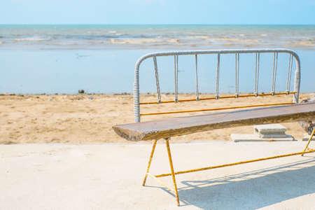 beside: wooden chair beside the beach Stock Photo