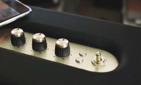 turn dial: golden music controller button on vintage filter