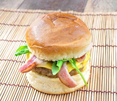 pork hamburger on wood plate