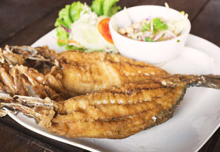 Fried Snapper topped with sauce