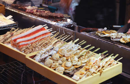 a lot of grilled seafood in wood box Foto de archivo