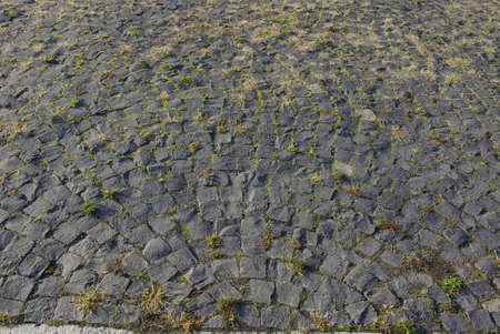 abstract background of cobblestone pavement of stone blocks