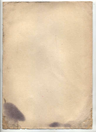 Vintage paper with folds, dark shabby edges, with spots and torn corners.