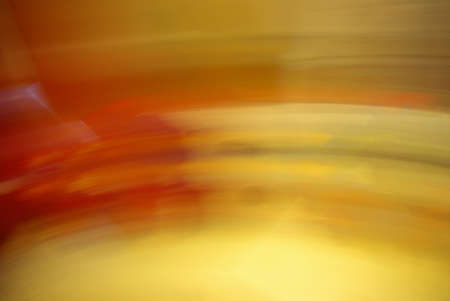 Abstract colorful stripes and spots of light texture with a dark background. Slow shutter speed. 免版税图像
