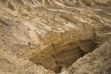 Sand quarry. Texture. Traces of production.