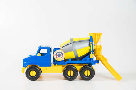 Plastic car. Toy model isolated on a white background. Yellow-blue concrete truck.