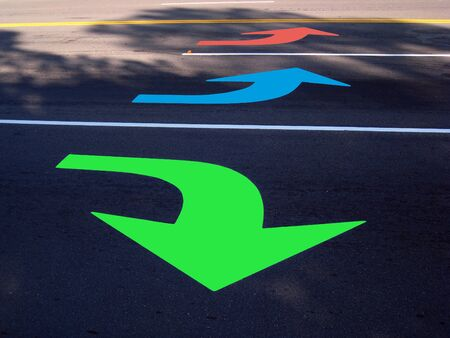 Colorful sign of arrows on the ground.
