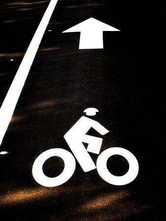 Bike traffic sign on the ground.
