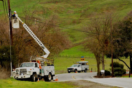 telephone pole: highline boom truck with man Stock Photo