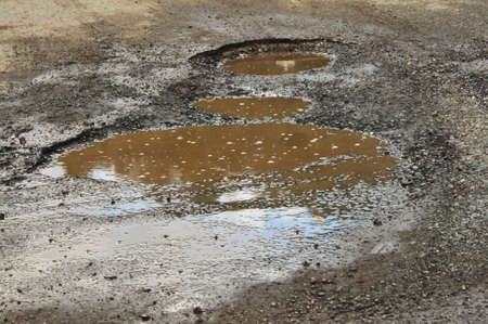 allocate: muddy pothole