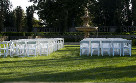 white folding lawn chairs set for event