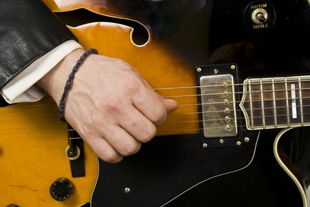 folk music: playing guitar close-up