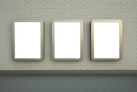 citylight: Blank citylight banners hanging on a white brick wall