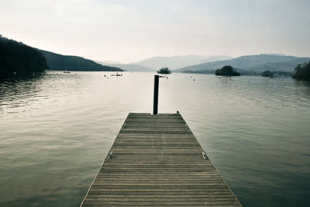 a pier on Lake Windermere, UK photo