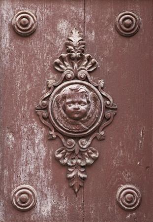 embellished: Wooden ornament on a historic church door in Zadar, Croatia