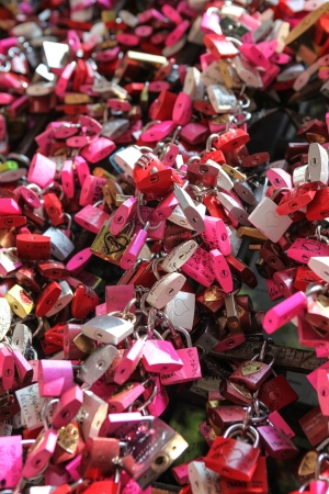 juliets: Verona, Italy - July 18, 2013, Padlocks as symbols of romantic love, hung by tourists at famous Juliets House in Verona, Italy