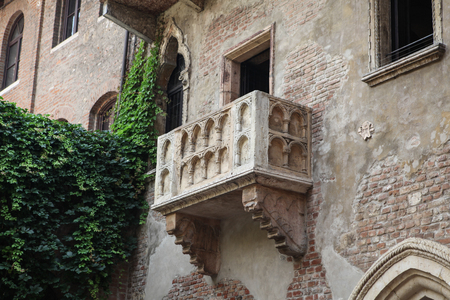 believed: Verona, Italy - July 18, 2013, Famous balcony at the Juliets House in Verona, northern Italy , one of the most popular attractions in the town, widely believed to be the place of the tragedy Romeo and Juliet by William Shakespeare