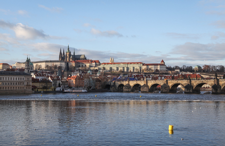 Prague, Czech Republic – January 02, 2013 - View at the Prague Castle in Hradcany district and the Charles Bridge crowded with tourists over the Vltava river in Prague, Czech Republic  Stock Photo - 22383137