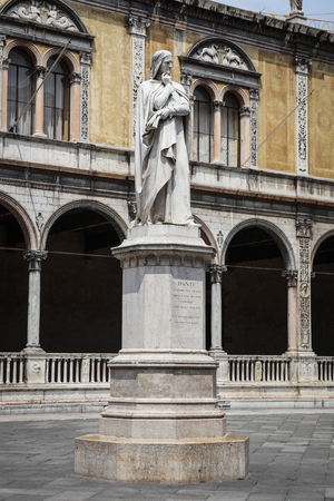 Verona, Italy – July 18, 2013 – Dante Alighieri marble statue by Ugo Zannoni, situated at Piazza dei Signori  also known as Piazza Dante  in UNESCO listed historic city of Verona, Italy   Stock Photo - 22493254