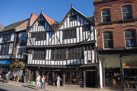 York, United Kingdom - September 22, 2013 - View at York s oldest Tudor building called Sir Thomas Herbert�s House at 14 Pavement in York, UK, with pedestrians passing by  Stock Photo - 22493256