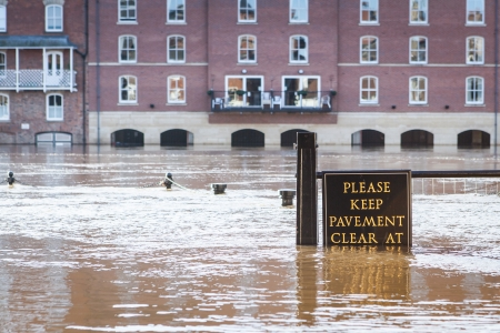 contributed: York, United Kingdom, December 25, 2013 - Flooded pavement sign at the bank of the River Ouse in the centre of York, UK  Heavy rains in December 2013 contributed to the overflow of the River Ouse, flooding nearby areas in York city centre