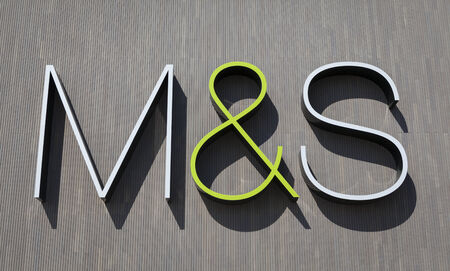 spencer: York, United Kingdom, April 15, 2014 - Marks Spencer logotype on the wall of the M S store in York  Marks Spencer plc is a major British retailer founded in 1884, specializing in selling food, clothing and home products Editorial