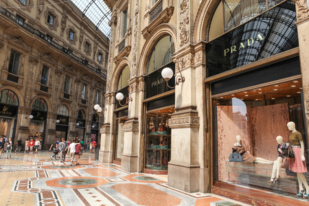 prada: Milan, Italy - July 9, 2013  Prada Store in Galleria Vittorio Emanuele II shopping center in Milan, Italy with shoppers and tourists strolling around  Prada is an Italian luxury brand and fashion house founded in 1913