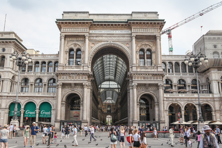world's: Milan, Italy - July 9, 2013  Crowded Piazza del Duomo in Milan with the entrance to the Galleria Vittorio Emanuele II, one of the world s oldest shopping malls
