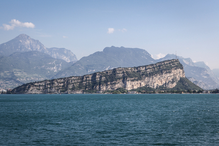 Lake Garda in Italy with Monte Brione and surrounding mountains photo