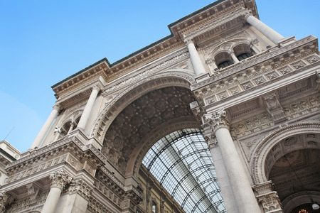 Beautiful facade of the 19th century Galleria Vittorio Emanuele II, famous shopping mall in Milan, Italy
