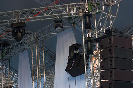 outdoor lighting: Studio lighting equipment high above an outdoor concert performance.