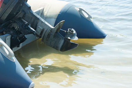 inflatable boat: Screw motor inflatable boat in the shallows