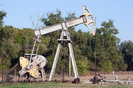obsolete: rusty obsolete pumpjack extract petroleum in Russia
