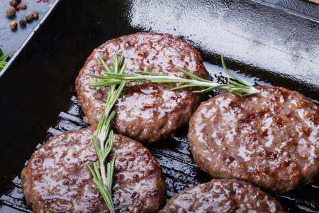Beef roasted cutlets on grill pan with rosemary and seasonings