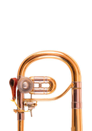 trombon: Uno Tromb�n alto en el fondo blanco Foto de archivo