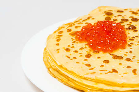 rubicund: some roasted pancakes on the white plate on white background Stock Photo