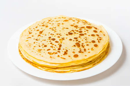 some roasted pancakes on the white plate on white background 版權商用圖片