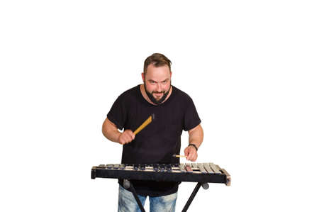 One percussion player isolated on white  play on campanelli Stock Photo