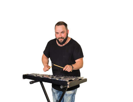 One percussion player isolated on white  play on marimba