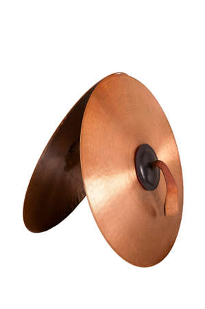 cymbals: Close up of an prcussion cymbals with leather handle  isolated on background.