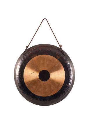 the image of the old traditional gong.percussion instrument tom-tom isolated on white hanging on a rope