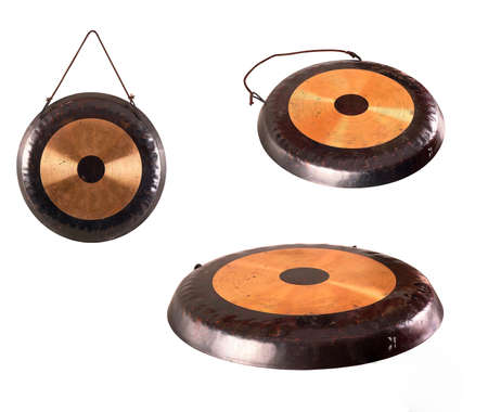 thai musical instrument: the image of the old traditional gong.percussion instrument tom-tom isolated on white hanging on a rope